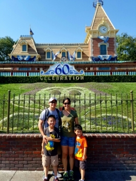 Family pic by the entrance to Disneyland.